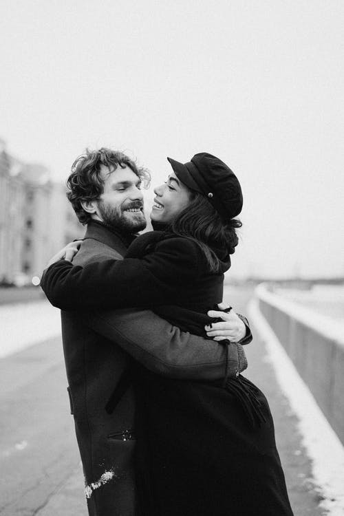 Monochrome Photo Of Woman Hugging Man