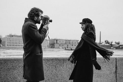 Man Wearing Coat Holding Vintage Camera