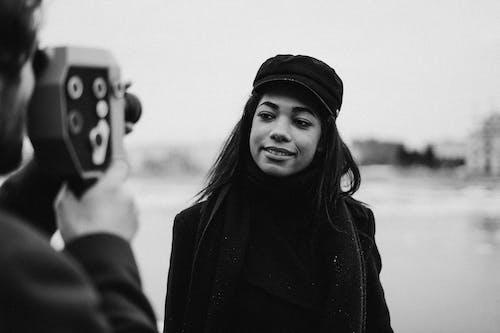Monochrome Photo of Woman Wearing Black Hat