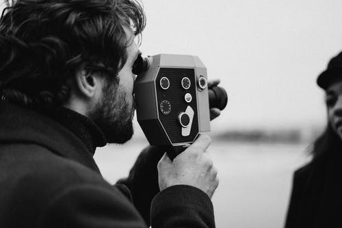 Bearded Man Holding a Analog Camera