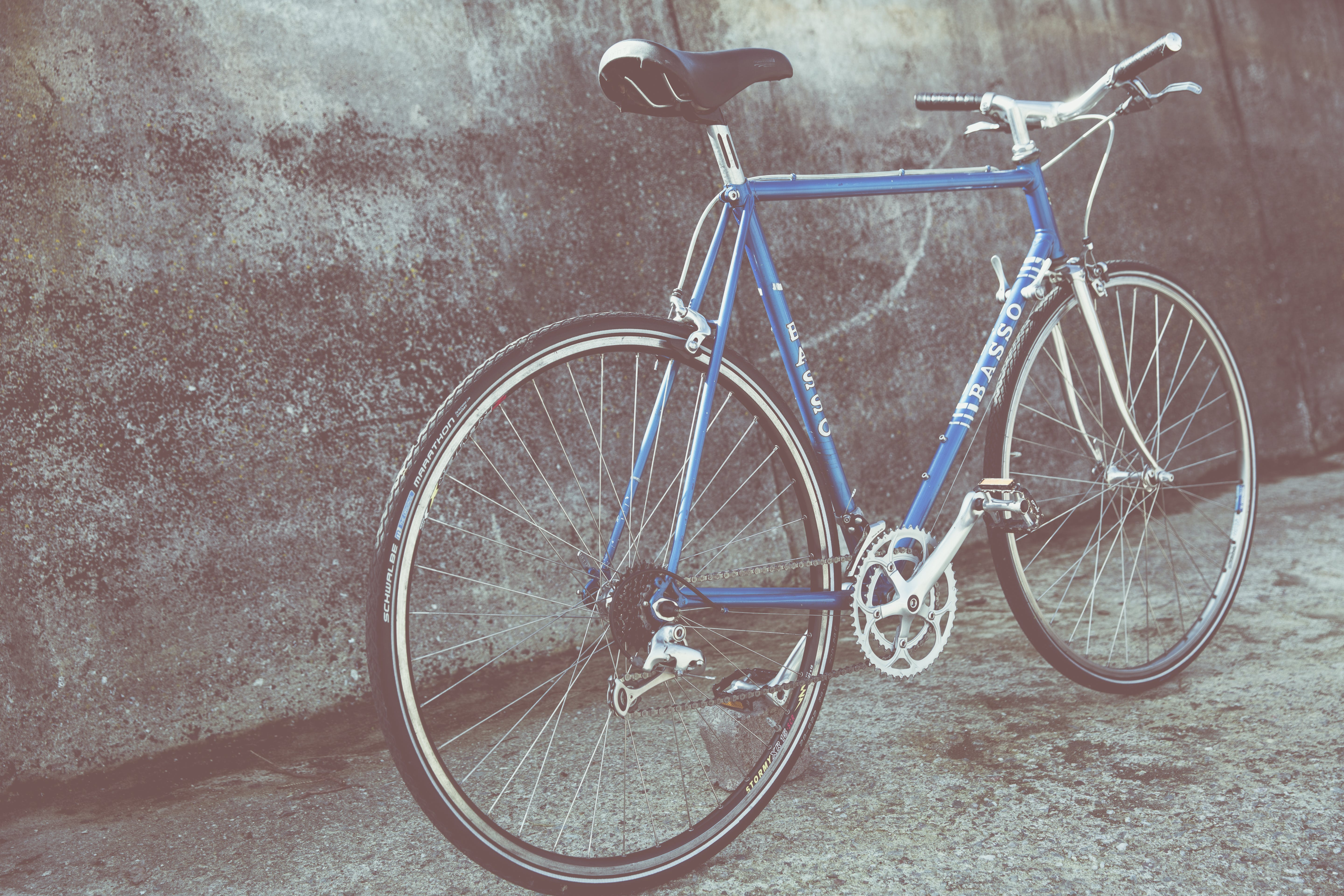 Blue Mountain Bicycle Beside Concrete Wall