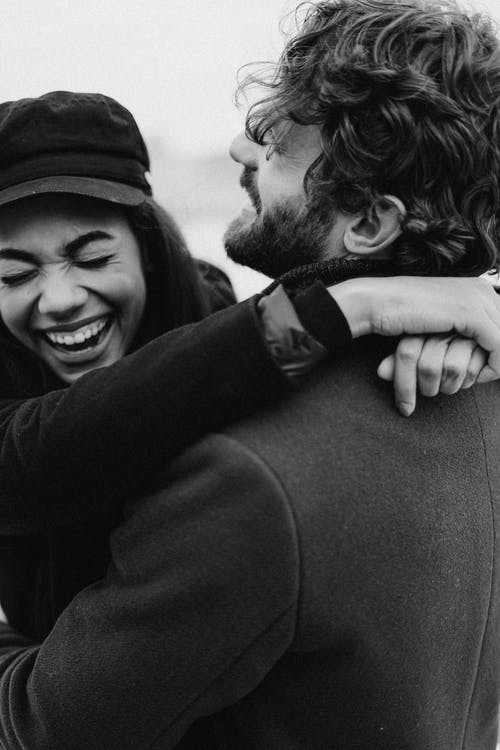 Monochrome Photo of Couple Laughing