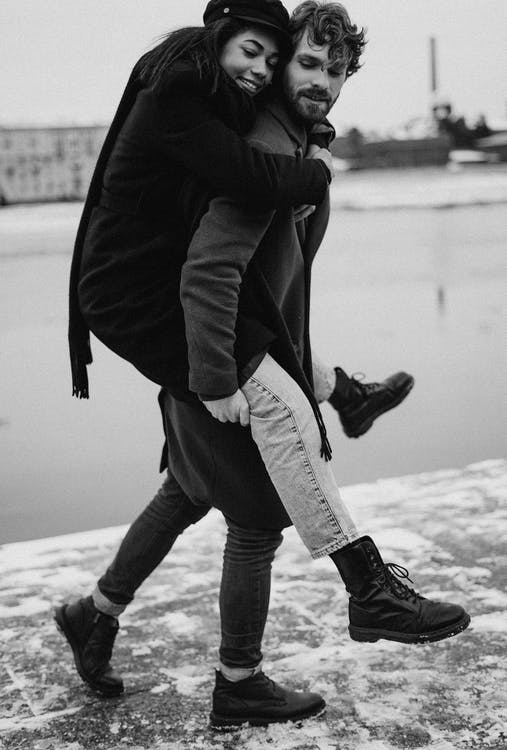 Man Walking While Carrying His Woman
