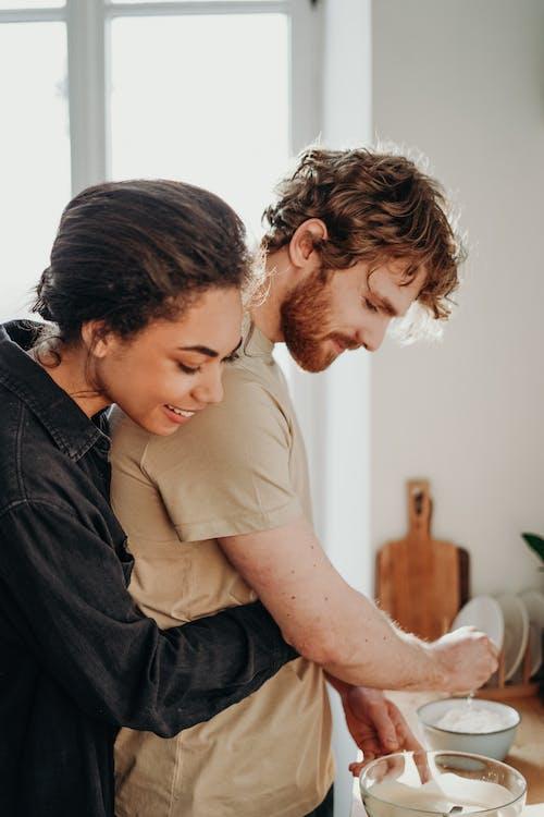 Photo Of Woman Hugging Man