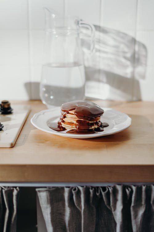 Chocolate Pancakes on White Ceramic Plate