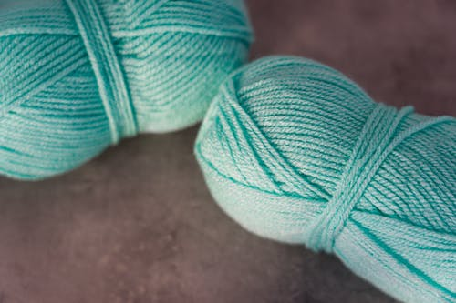 Teal Yarn on Gray Surface