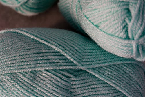 Close-Up Photo of Teal Yarn