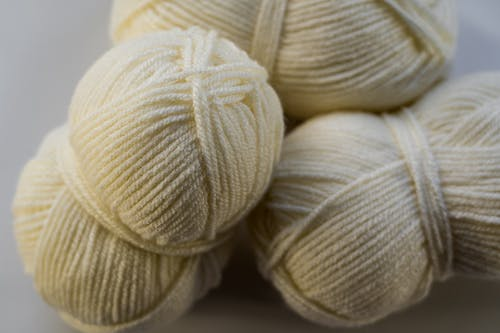 Close-Up Photo of Ivory Yarn