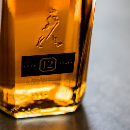 Close-Up Photo of Alcohol Bottle