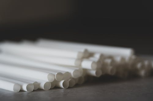 Selective Focus Photo of White Drinking Straws