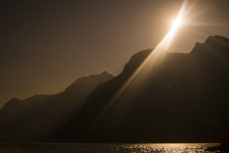 Free stock photo of back light, mountains, sun, sun ray