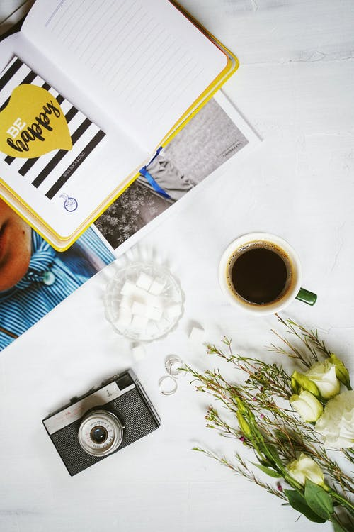 Photo of Diary Beside a Coffee Mug