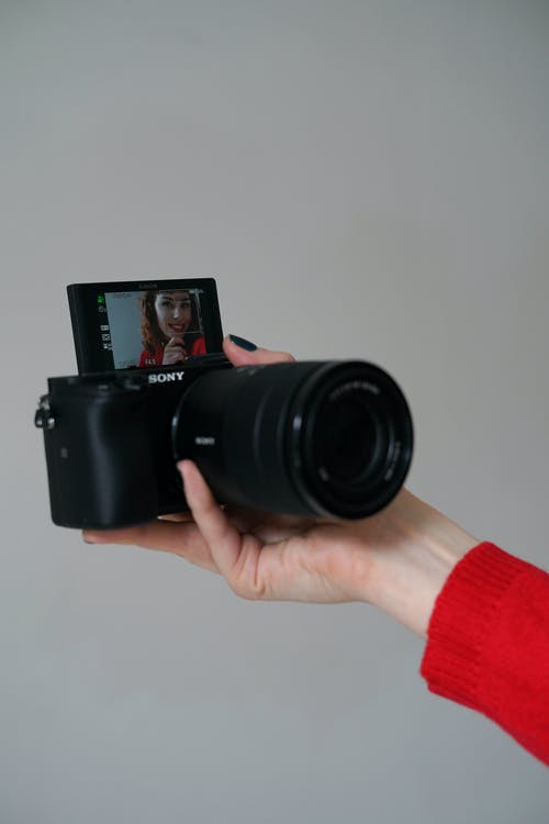 Photo of a Woman Taking a Selfie