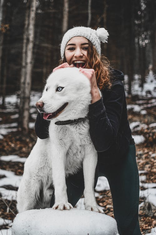 Woman Holding Her White Dog
