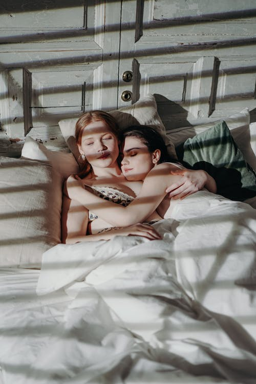 2 Women Lying on Bed