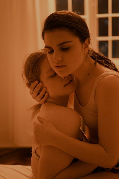 Woman Hugging a Woman