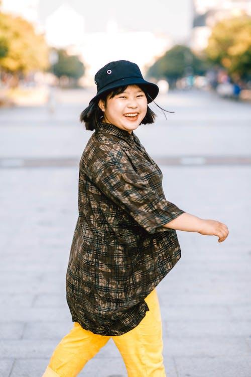 Photo Of Woman Wearing Black Bucket Hat