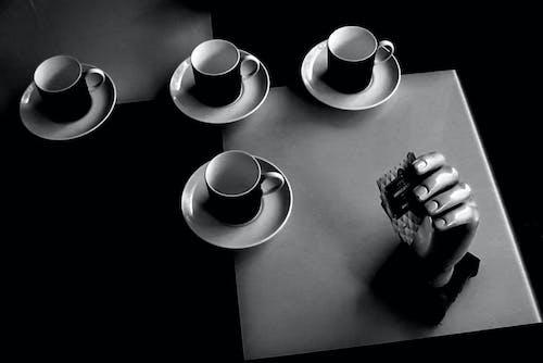 Gray Scale Photo of Black and White Ceramic Coffee Mug