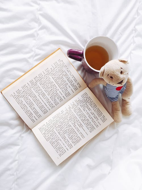 Purple Ceramic Cup and Page of Book