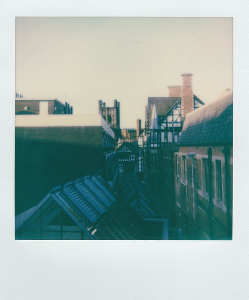 Instant Photo Of Wooden Houses