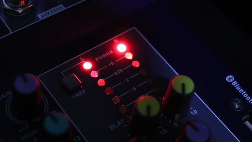 Close-up View Of An  Audio Mixer Control Panel