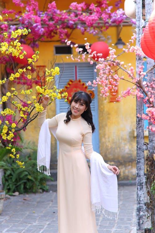 Photo Of Woman Wearing Peach Dress