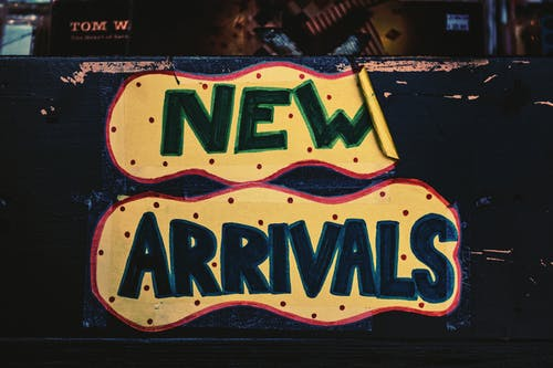 New Arrivals Sign On Wooden Surface