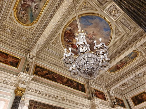 Stunning Chnadelier under Baroque Inspired Ceiling