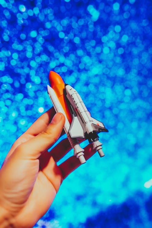 Person Holding Space Rocket Toy