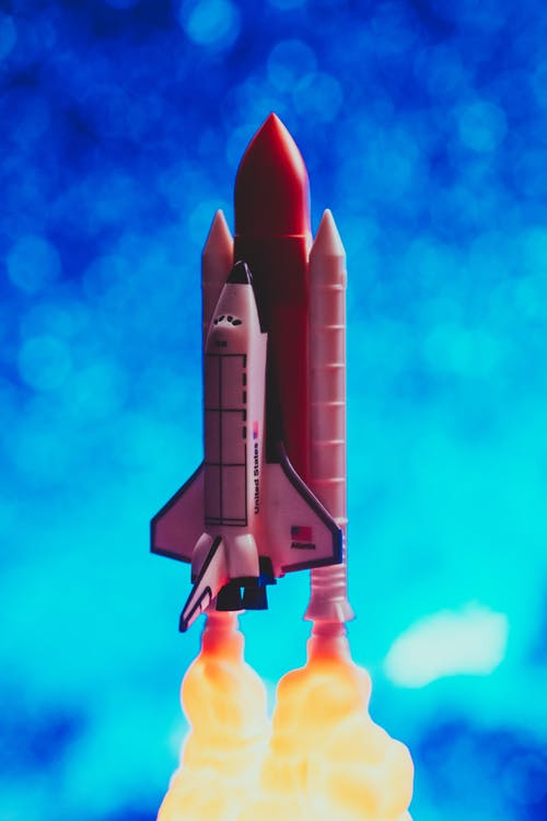 Miniature Of A Brown Rocketship With Blue Background