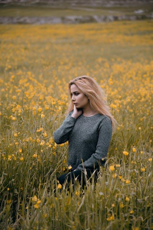 Woman in Gray Sweater Standing on Yellow Flower Field