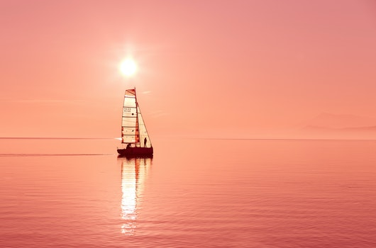 Boat on Body of Water during Sunset