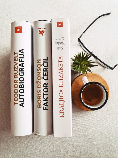 Books Beside Jar and Eyeglsses