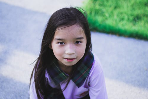 Girl in Purple Long Sleeve Shirt with Green and Black Plaid Collar