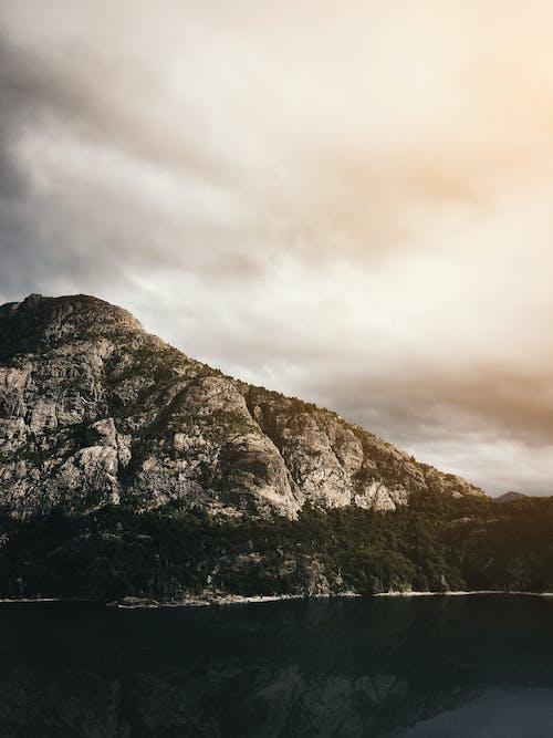 Foto stok gratis Argentina, gunung, matahari terbenam, sungai