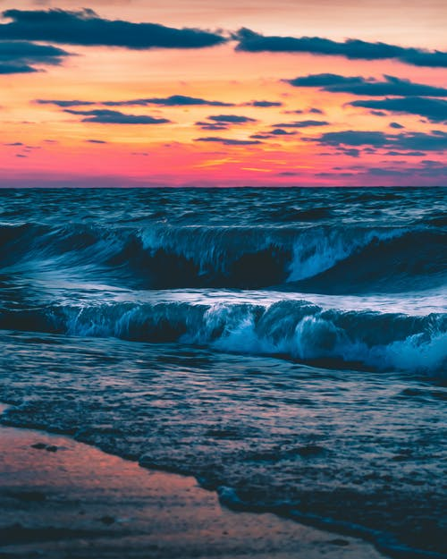 Ocean Waves Crashing on Shore during Sunset