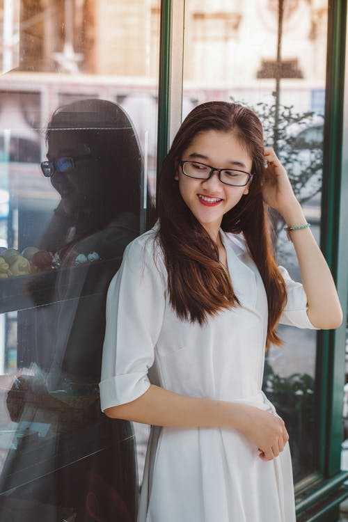 Woman in White Button Up Shirt Dress Smiling
