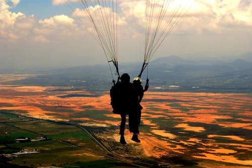 Silhouette of Person on Parachute during Sunset