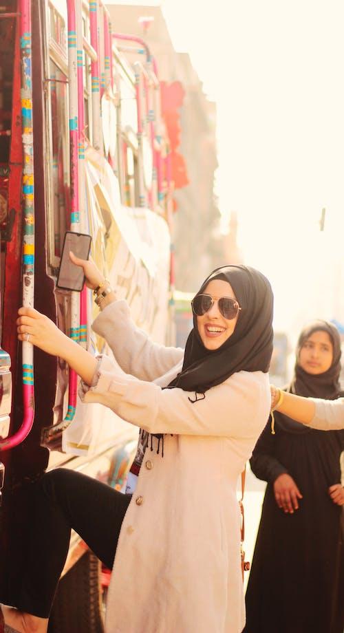 Woman in Black Hijab Holding Smartphone