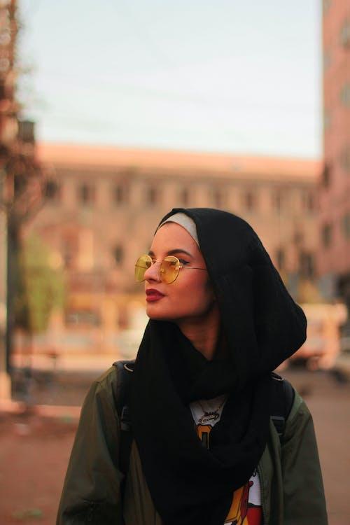Woman in Black Hijab and Yellow Eyeglass