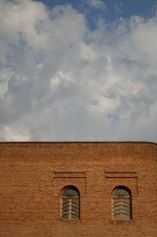Free stock photo of arched windows, clouds sky, glass windows, Historic Building