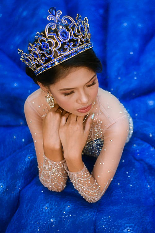 Woman in Blue Gown Wearing Blue Crown