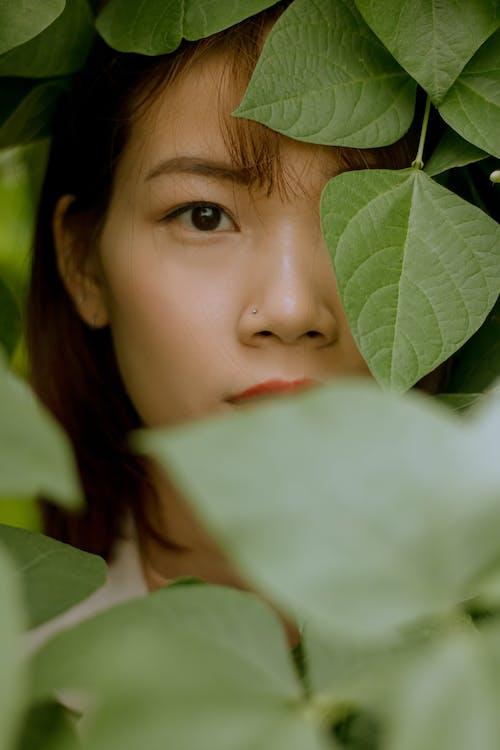 Girls Face on Green Leaves