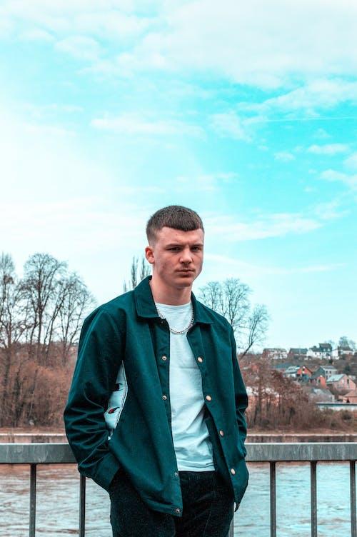 Photo of Man Wearing Green Jacket