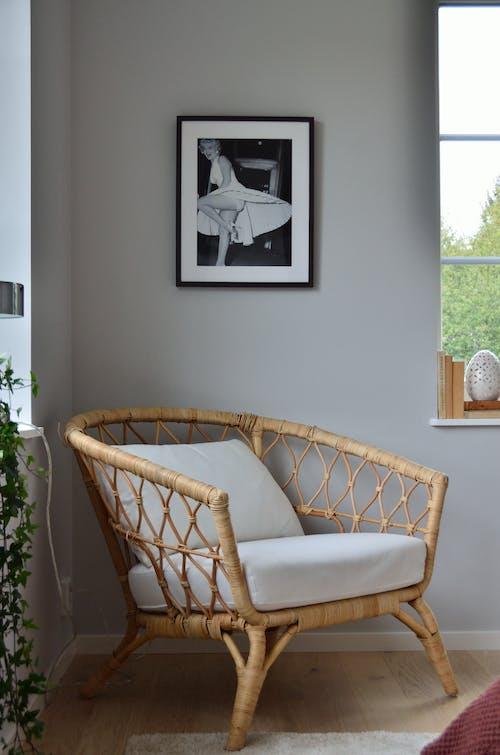 White Wicker Armchair Near White Wall