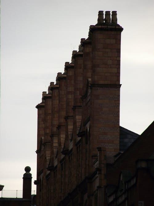 Free stock photo of brick chimneys, chimneys, city skyline, rooftops