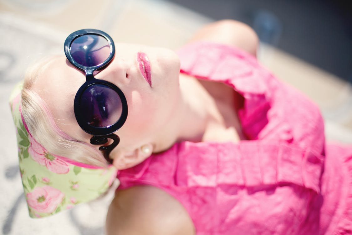 Woman Wearing Pink Shirt and Sunglass