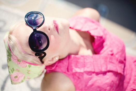 Woman Wearing Pink Shirt and Sunglass