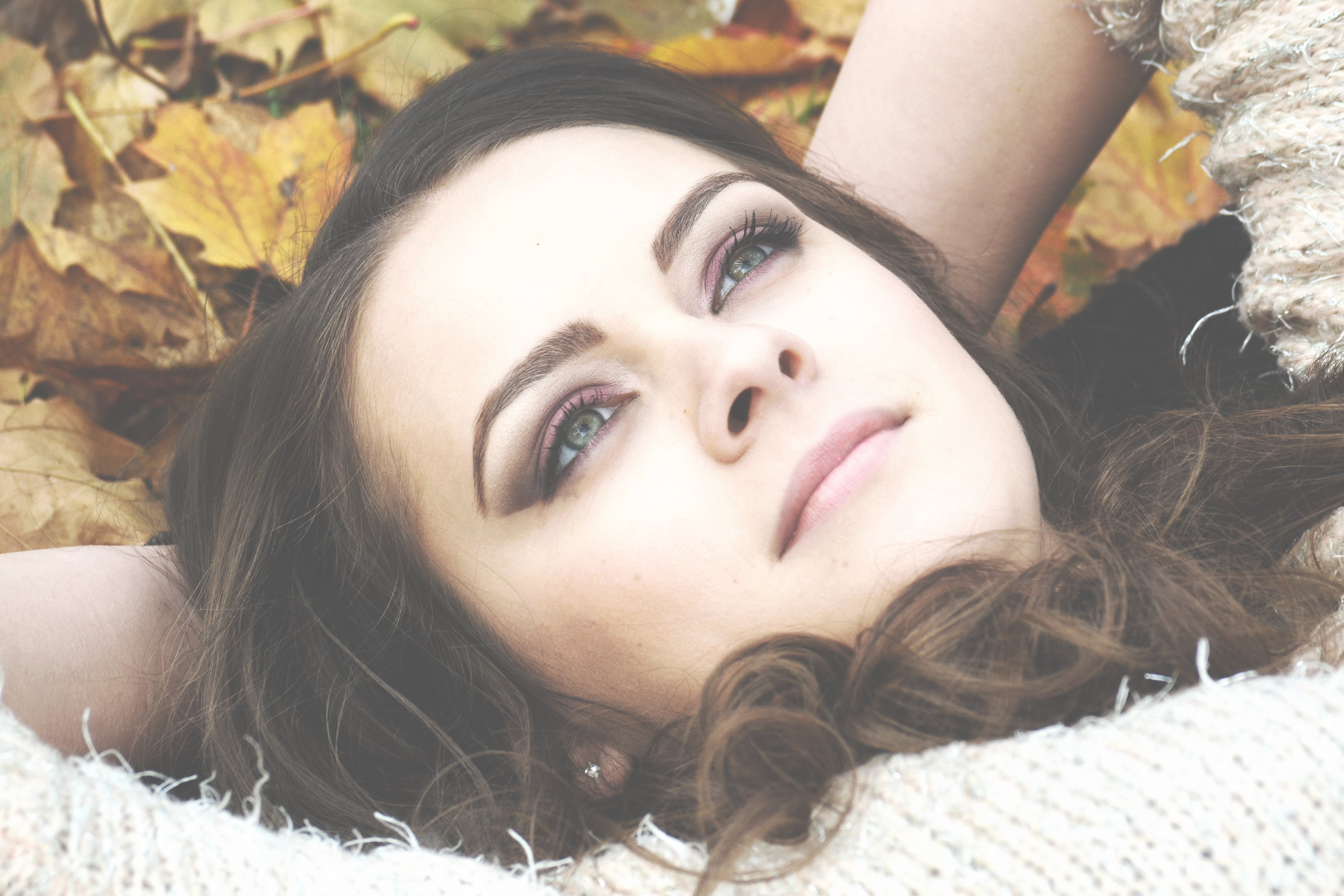 Woman Lying on Withered Leaves