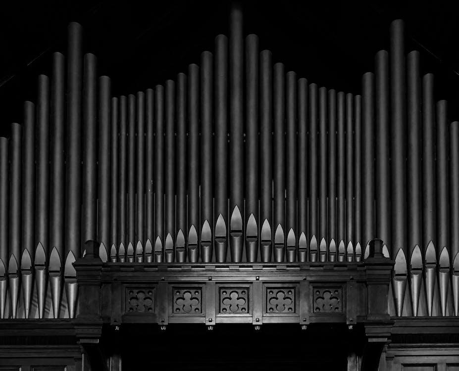 Grayscale Photo of Piano Keys